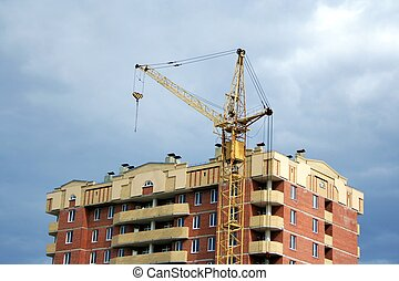 Lifting crane on the building new house
