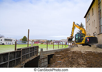 construction machinery and excavator on the background of house. Concept of building buildings, bridges and roads