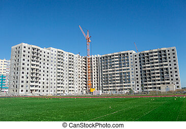 Construction machinery and multistorey houses under construction