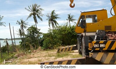 Construction machines working in tropical forest. Side view ...