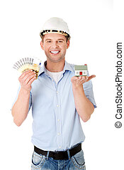 Construction man holding house model and money