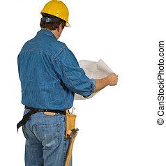Construction Man reviewing building plans