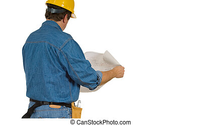 Construction Man reviewing building plans