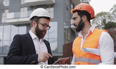 Construction manager and architect man are discussing the...