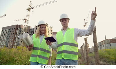 Construction Manager And Engineer walk Working On Building...