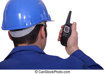 construction manager with a talkie walkie
