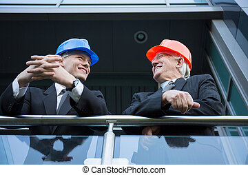 Construction managers in helmets