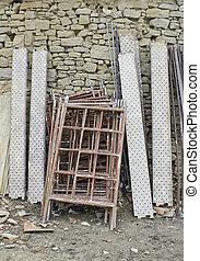 Construction Material - Construction material piled on a ...