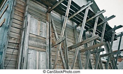 Construction of a frame wooden house outdoor - Construction...
