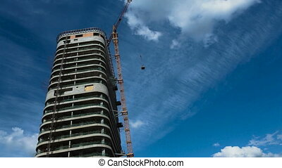 Construction of a high-rise building, unfinished residential...