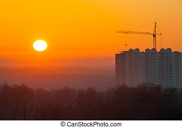 Construction of a house at dawn