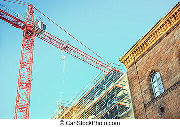 Construction of a modern building in the city of Furth in Germany. Construction crane.