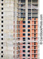 Construction of a modern building made of brick and concrete
