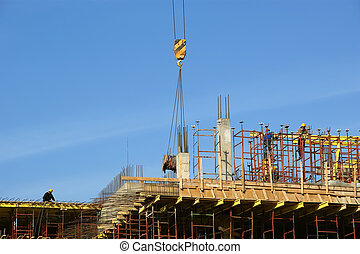 Construction of a modern building of metal and concrete