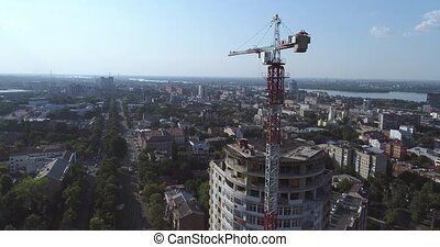 Construction of a multi-storey building, Tower crane, Unfinished multi-storey building, Building a high rise, Panoramic view