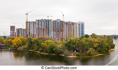 Construction of a multistorey building near the river in the autumn
