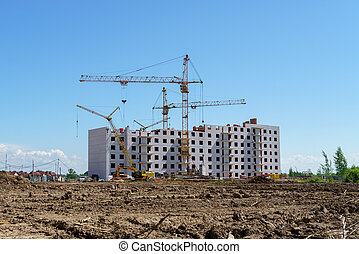 Construction of a multistory building. Cranes work