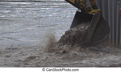 Construction of a new bridge on river instead of old wooden one. Excavator bucket selects soil from bottom of river. Super slow motion 1000 fps
