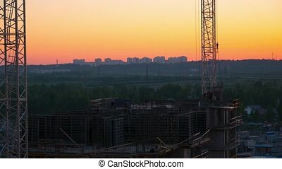 Construction of a new residential house in the evening at sunset. Time-lapse