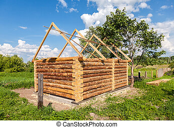 Construction of a new wooden bath house in Russian village