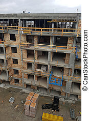 Construction of a residential building in the city, multi-storey and apartment building.