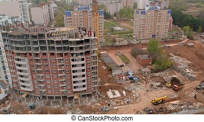 Construction of a residential high-rise building. Aerial shooting from the drone