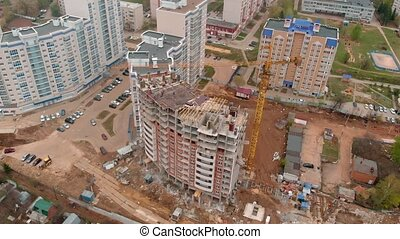 Construction of a residential high-rise building. Aerial...