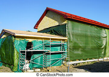 construction of a residential house from blocks, technological treatment of the facade