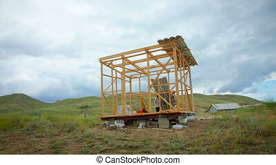 construction of a summer house in the afternoon