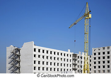 Construction of a white brick residential building