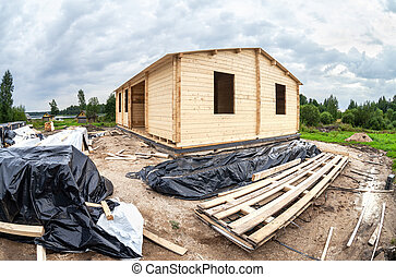 Construction of a wooden house on the stone foundation