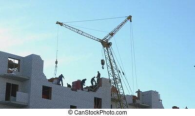 Construction of an apartment building. Crane