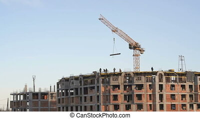 Construction of an apartment building in winter -...