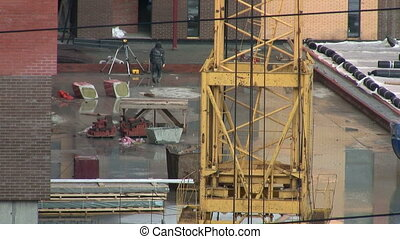 Construction of concrete buildings with crane construction after rain