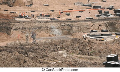 Construction of foundation on large building site outdoors....