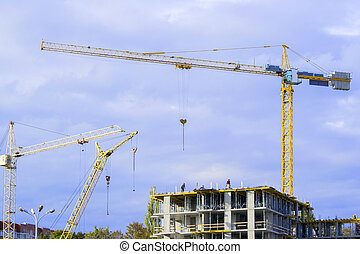 Construction of high-rise buildings.