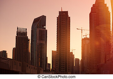 construction of high-rise buildings on background sunrise