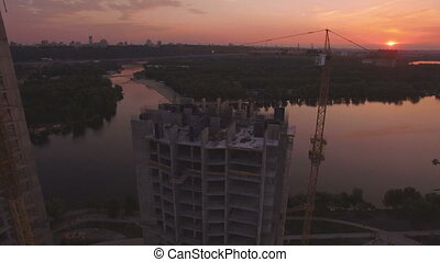Construction of houses at sunset aerial drone footage