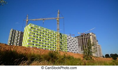 Construction of houses of different architecture in Moscow,...