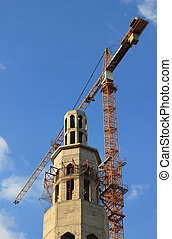 Construction of mosque with crane