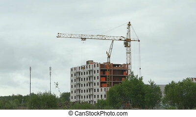 The construction of multi-storey apartment buildings in the residential complex