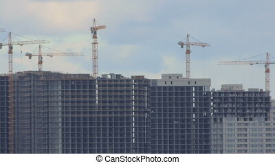 Construction of multi-storey buildings. Time-lapse.