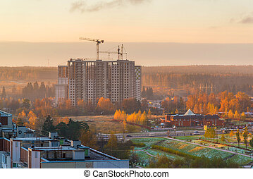 Construction of multi-storey residential house at dawn