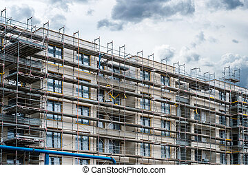 construction of new apartment building , scaffolding on real estate development