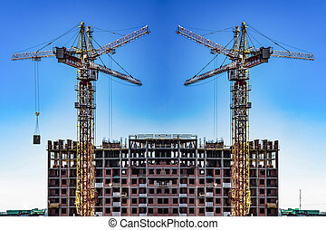 Construction of new residential buildings against the sky .