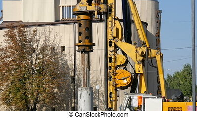 Construction of new subway station. A huge crane pours...