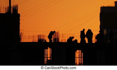 Construction of residential building. Builders go on the...