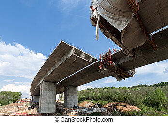 Construction of the bridge by the prestressed concrete...