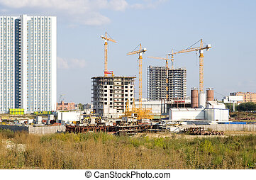 Construction of the multi-storey apartment houses, in city, ...