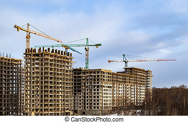 Construction of the third stage of a new residential complex 'in the forest'. Work construction cranes, is the construction of walls of buildings. Moscow, Russia